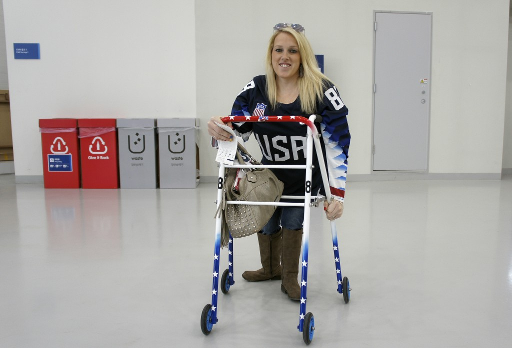 In this March 11, 2018, photo, Erica Mitchell, a Chicago native and an accomplished player in women's sled hockey, who came to the games as a spectato...