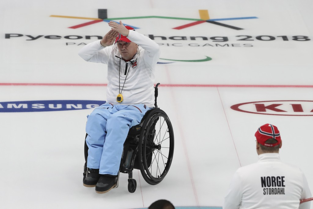 Norway's Rune Lorensten calls for time out during the Wheelchair Curling gold medal match against China for the 2018 Winter Paralympics at the Gangneu...