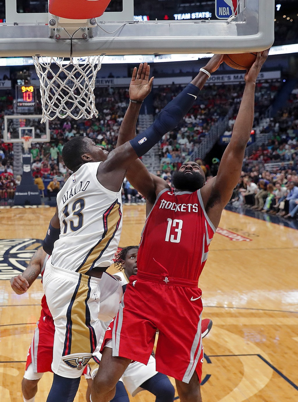 New Orleans Pelicans forward Cheick Diallo (13) blocks a shot by Houston Rockets guard James Harden during the second half of an NBA basketball game i...