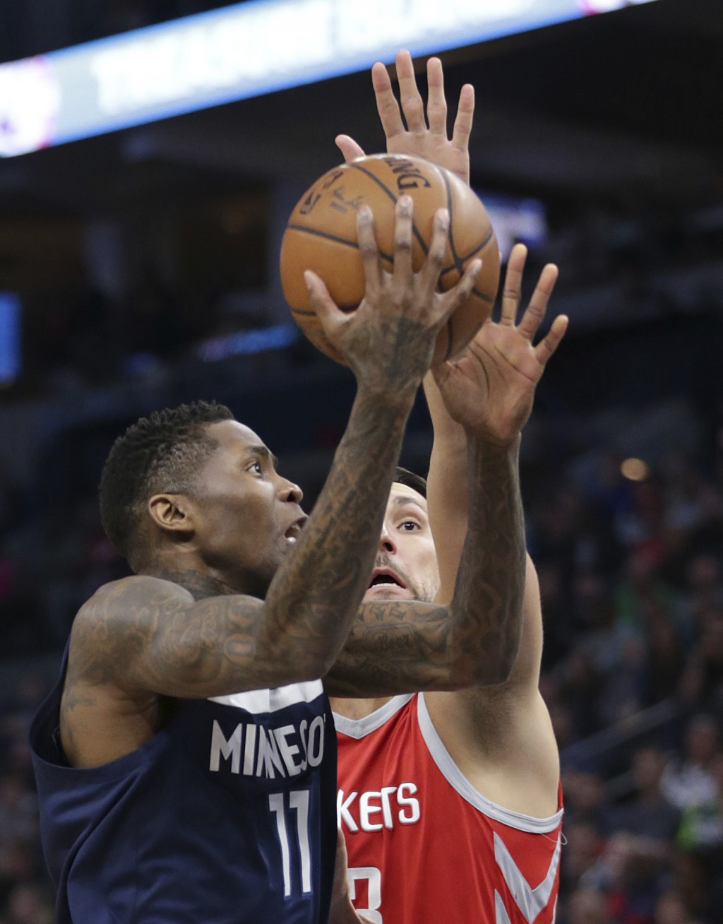 Minnesota Timberwolves guard Jamal Crawford (11) shoots over Houston Rockets forward Ryan Anderson (33) in the second quarter of an NBA basketball gam...