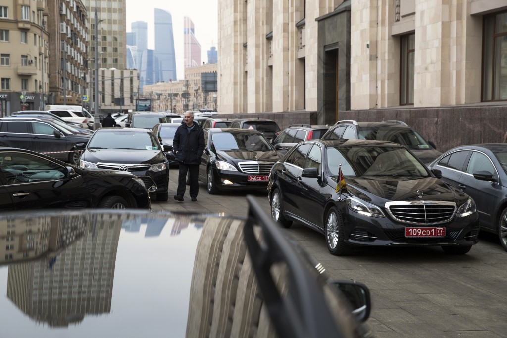Cars and limousines of invited foreign ambassadors in Moscow are parked as foreign envoys attend attend briefing at Russian Foreign Ministry building ...