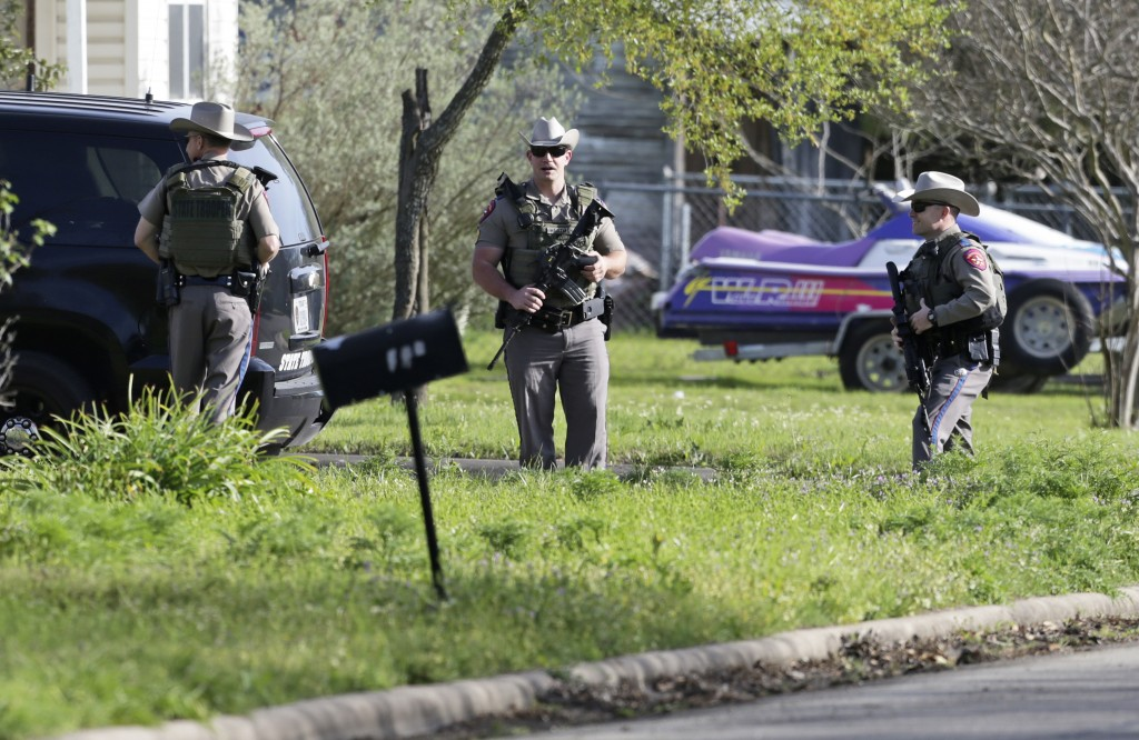 Law enforcement officers secure the neighborhood at the scene of Walnut and 2nd Street in Pflugerville, Texas, on Wednesday, March 21, 2018 where Aust...
