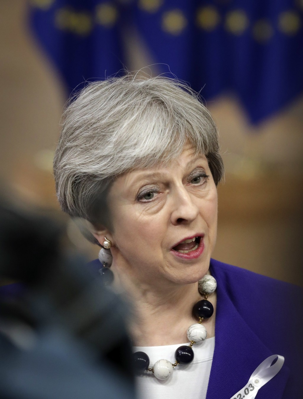 British Prime Minister Theresa May speaks with the media as she arrives for an EU summit at the Europa building in Brussels on Thursday, March 22, 201...