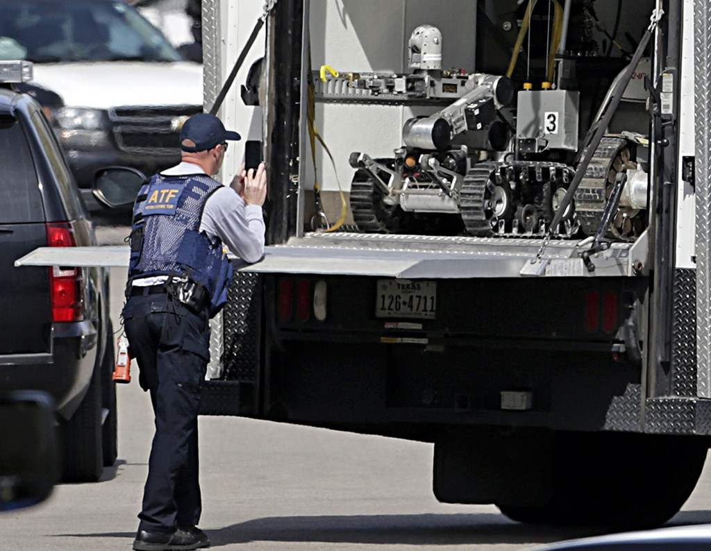 A robot is prepared for use at the scene of Walnut and 2nd Street in Pflugerville, Texas, on Wednesday, March 21, 2018 where Austin, Texas bombing sus...
