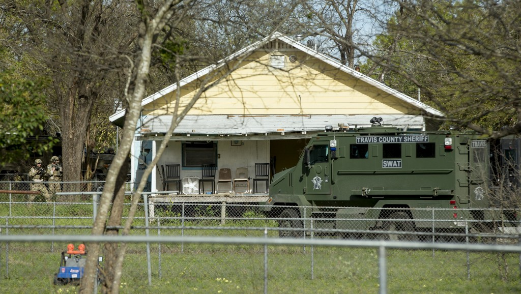 Authorities surround the home of the Austin bombing suspect Mark Conditt in Pflugerville, Texas, Wednesday, March 21, 2018. Authorities say Conditt, a...
