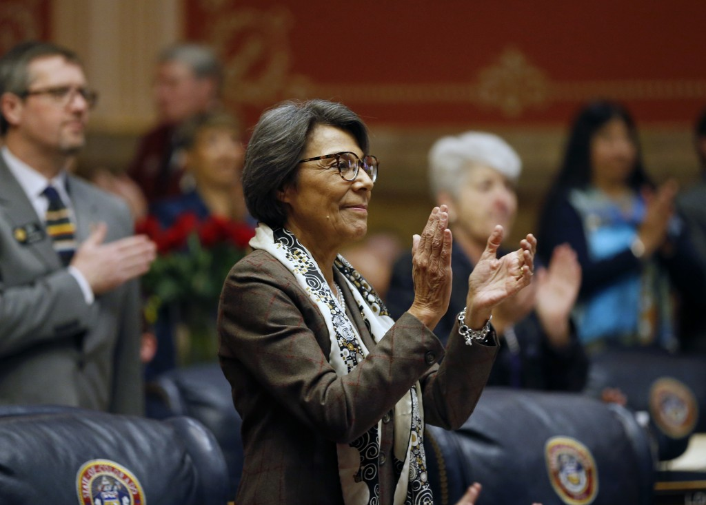 FILE - In this Jan. 11, 2017, file photo, state Sen. Lucia Guzman, D-Denver, applauds during the opening session of the 2017 Colorado Legislature at t...