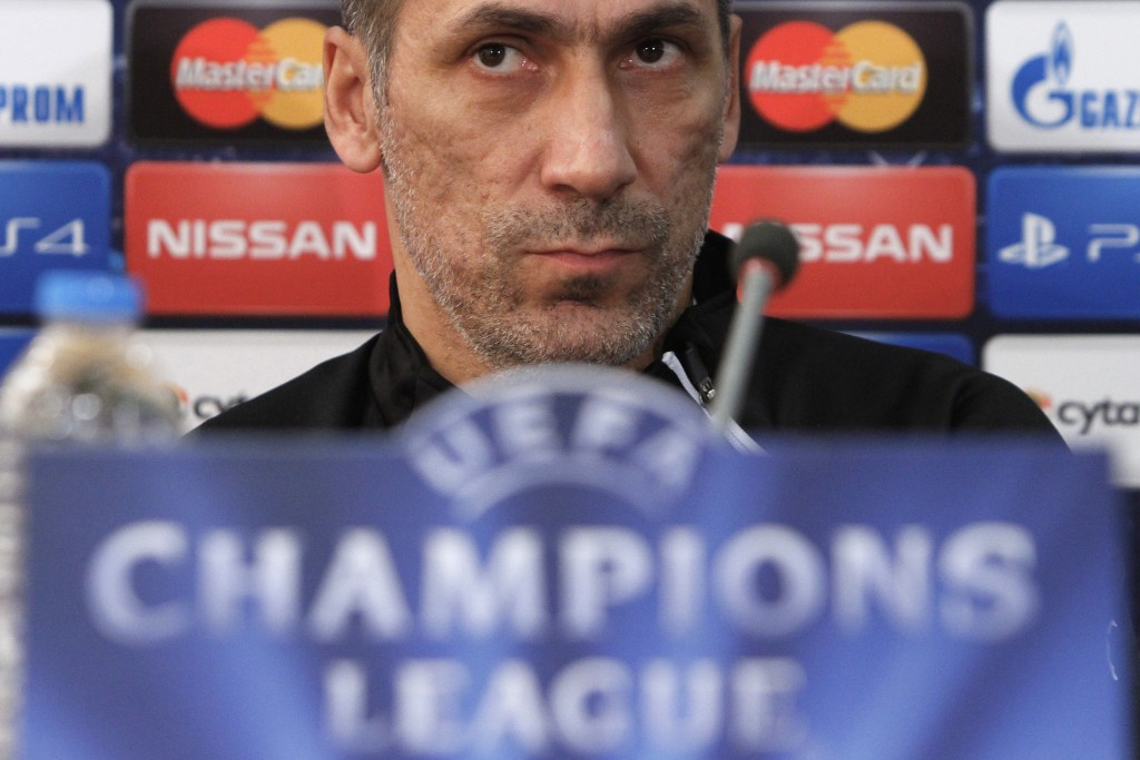 FILE - In this Monday, Oct. 20, 2014, file photo, APOEL coach Giorgos Donis attends a press conference before a training session of his team at GSP st...