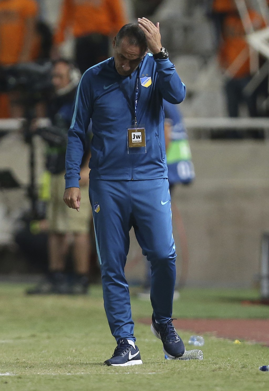 FILE - In this Tuesday, Sept. 26, 2017 file photo, APOEL Nicosia coach Giorgos Donis reacts during the Champions League Group H soccer match between A...