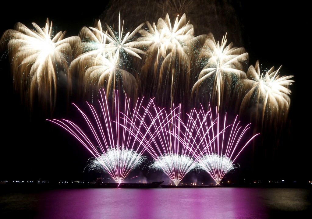 In this Saturday, March 24, 2018, file photo, fireworks from Polaris Fireworks of the People's Republic of China light up the sky on the last weekend ...