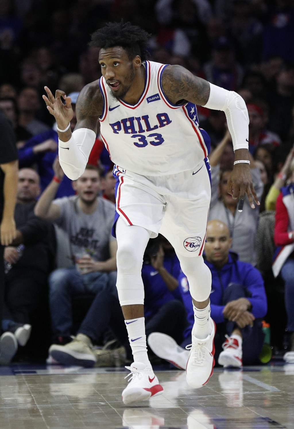 Philadelphia 76ers' Robert Covington reacts after his three-point basket during the first half of an NBA basketball game against the Minnesota Timberw...