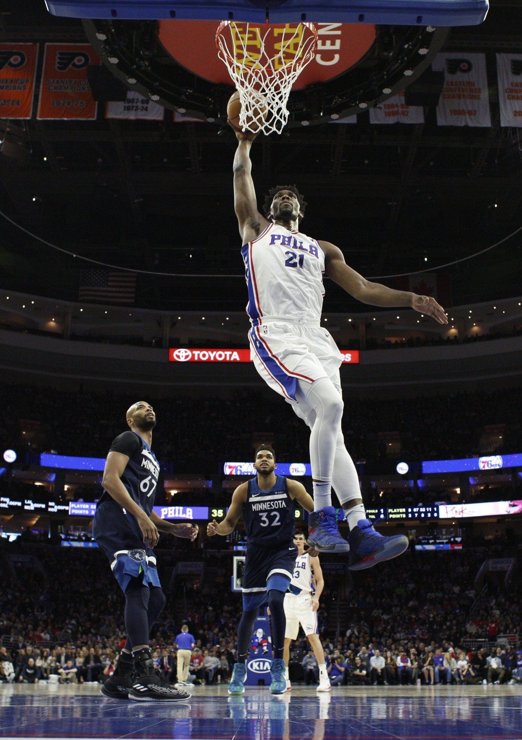 Philadelphia 76ers' Joel Embiid, of Cameroon, goes up for the dunk during the first half of an NBA basketball game against the Minnesota Timberwolves,...