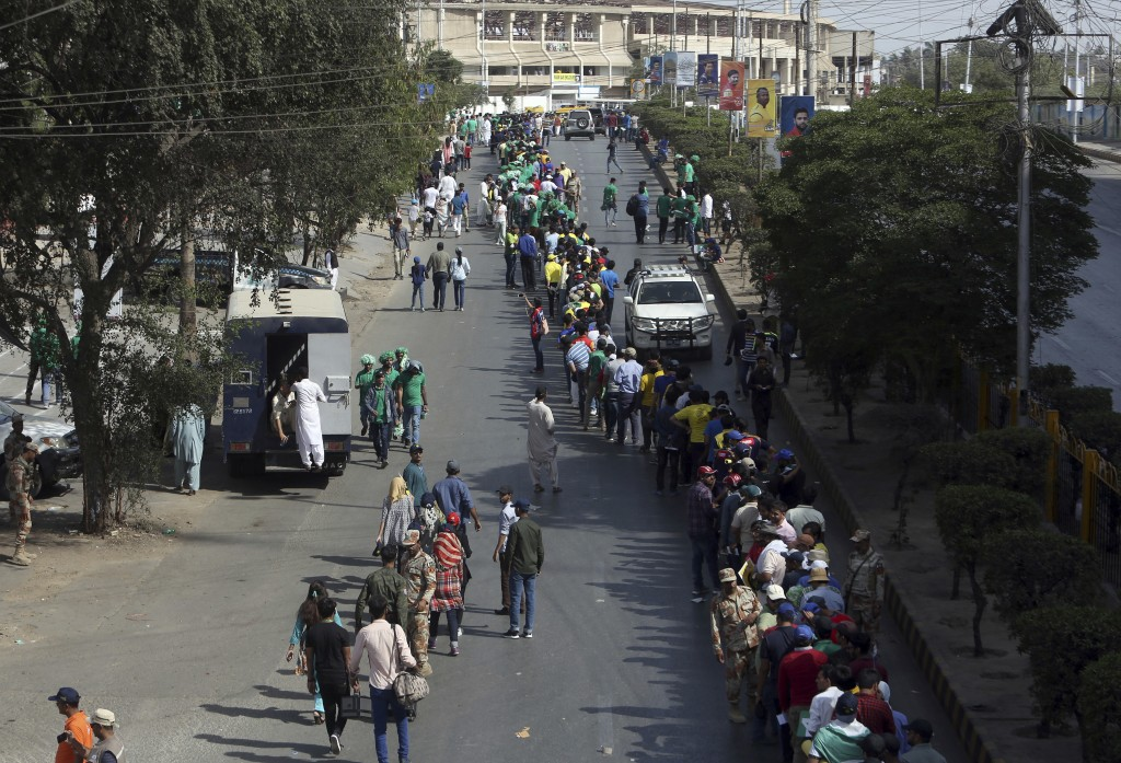 Cricket Fans Stand In A Long Queue To Enter In National Stadium For Pakistan Super League