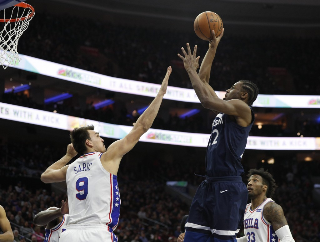 Minnesota Timberwolves' Andrew Wiggins, front right, shoots against Philadelphia 76ers' Dario Saric, left, of Croatia, during the first half of an NBA...