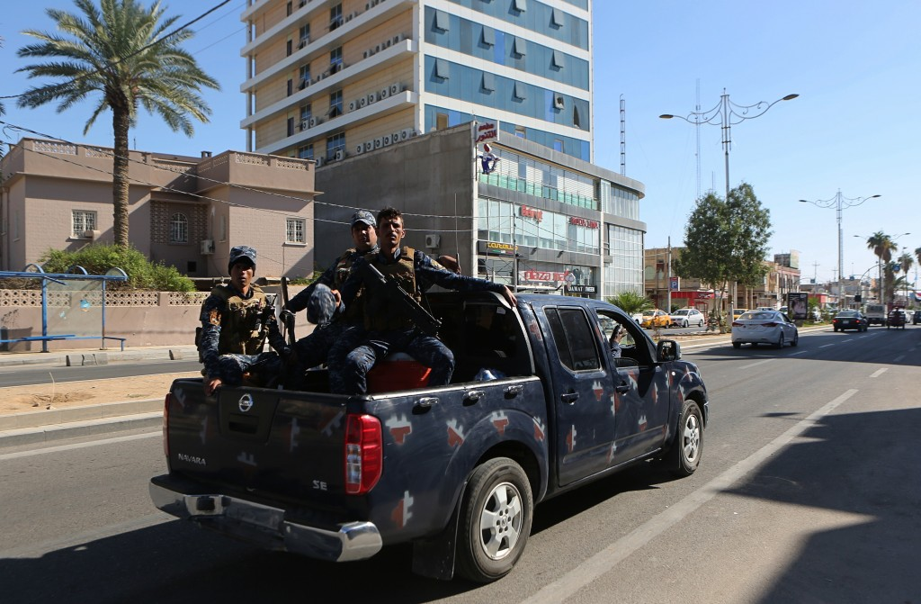 FILE - In this Oct. 19, 2017 file photo, federal Iraqi security forces patrol in Kirkuk, Iraq. Islamic State insurgent attacks and kidnappings are on ...