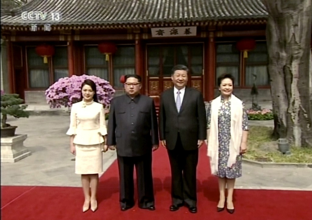 In this image taken from video footage run Wednesday, March 28, 2018, by China's CCTV via AP Video, North Korean leader Kim Jong Un, center left, and ...