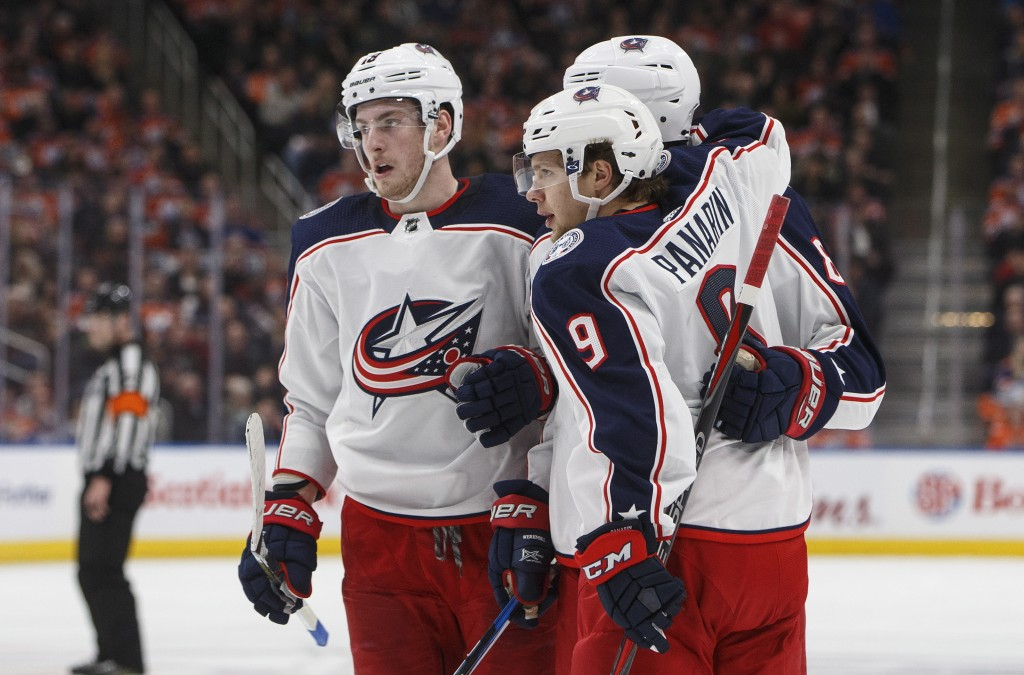 Columbus Blue Jackets players celebrate a goal against the Edmonton Oilers during first period NHL hockey action in Edmonton, Alberta, on Tuesday Marc...
