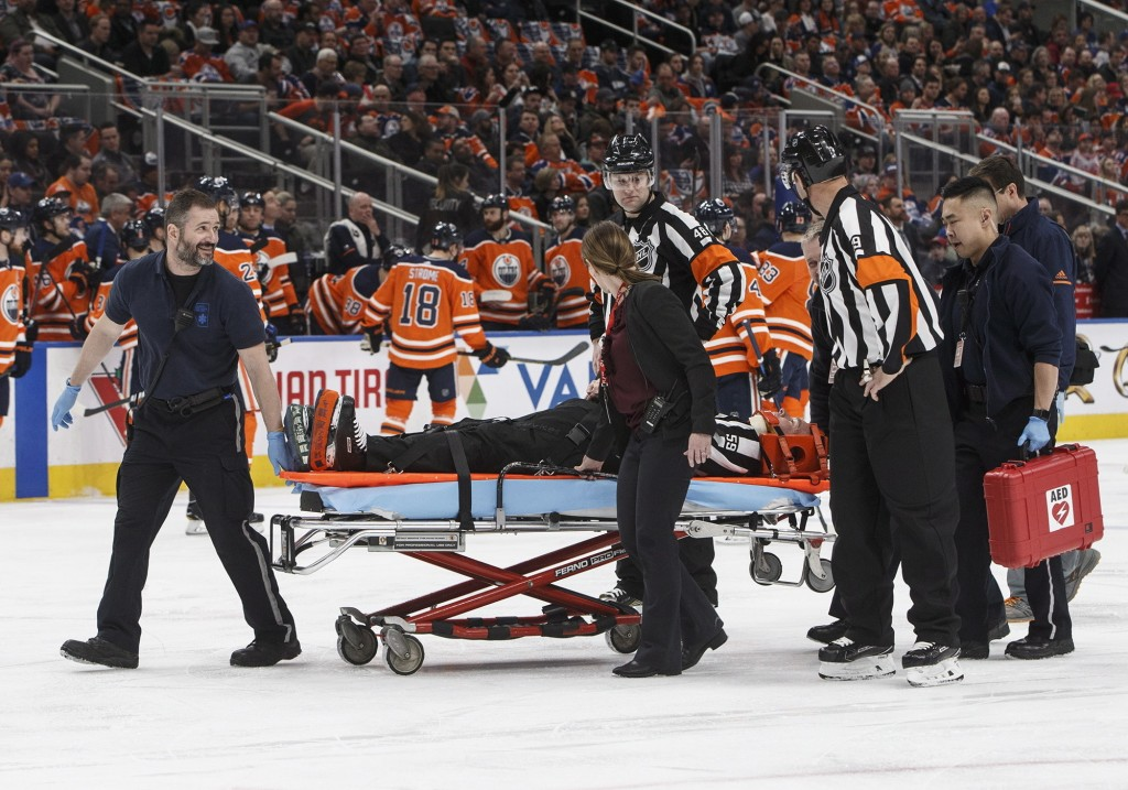 Linesman Steve Barton is taken off the ice after an injury as the Columbus Blue Jackets battle the Edmonton Oilers, during first period NHL hockey act...