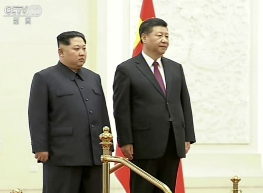 In this image taken from video footage run Wednesday, March 28, 2018, by China's CCTV via AP Video, North Korean leader Kim Jong Un, left, and Chinese...