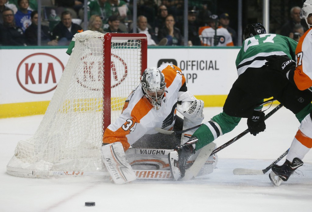 Philadelphia Flyers goaltender Petr Mrazek (34) deflects a shot by Dallas Stars right wing Alexander Radulov (47) during the first period of an NHL ho...