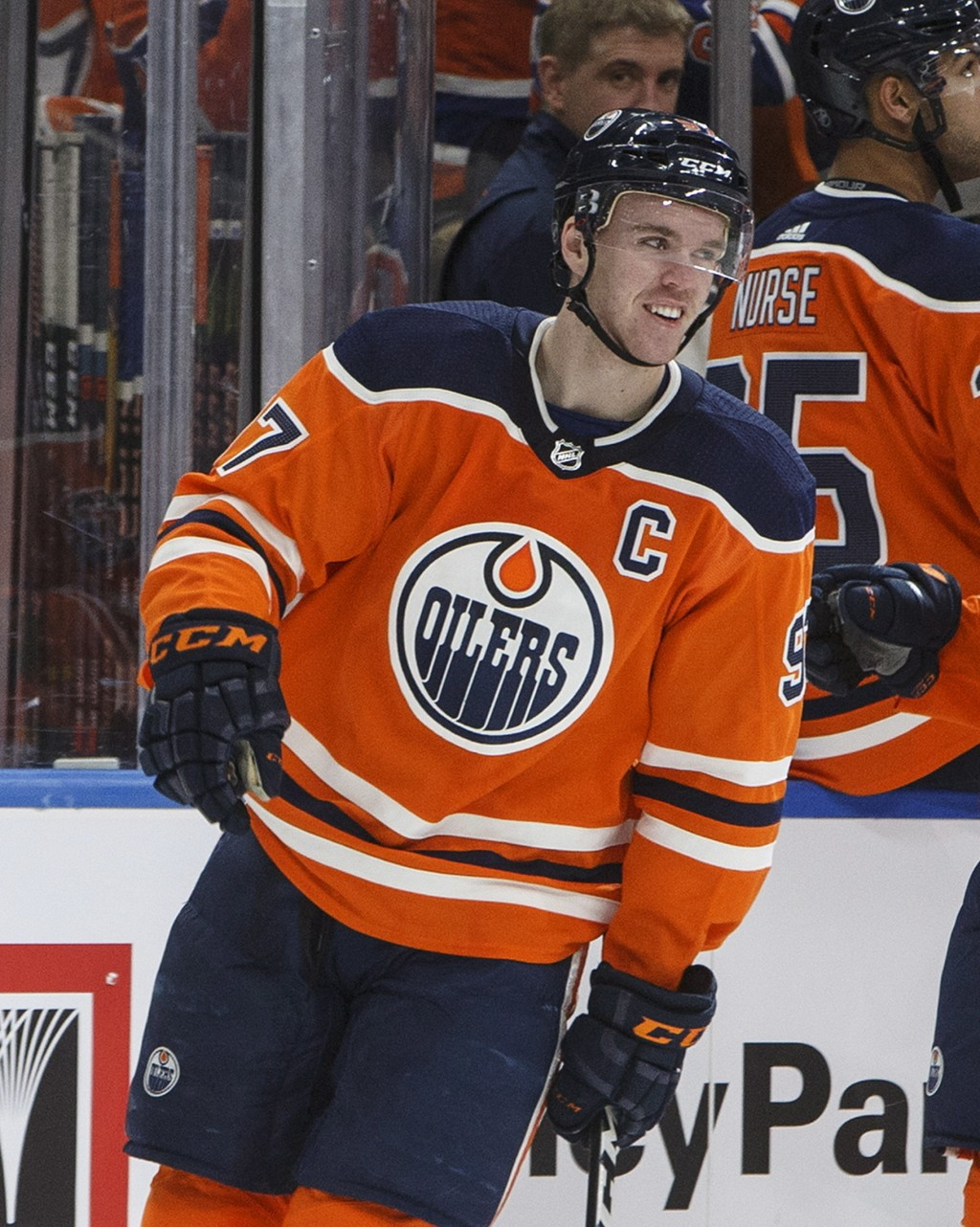 Edmonton Oilers' Connor McDavid (97) celebrates his 100th point of the season against the Columbus Blue Jackets during first period NHL hockey action ...