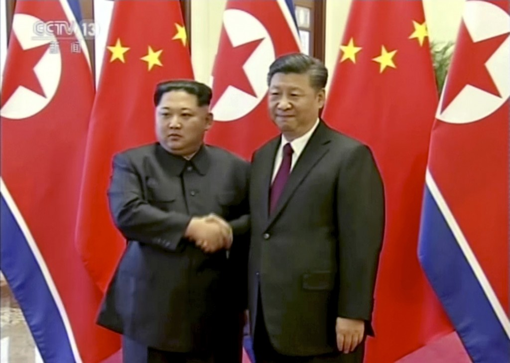 In this image taken from video footage run Wednesday, March 28, 2018, by China's CCTV via AP Video,  North Korean leader Kim Jong Un, left, and Chines...