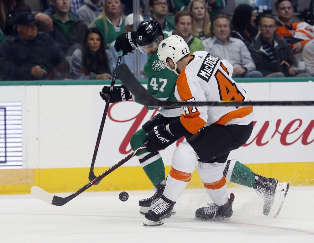 Dallas Stars right wing Alexander Radulov (47) battles Philadelphia Flyers defenseman Andrew MacDonald (47) for the puck during the first period of an...