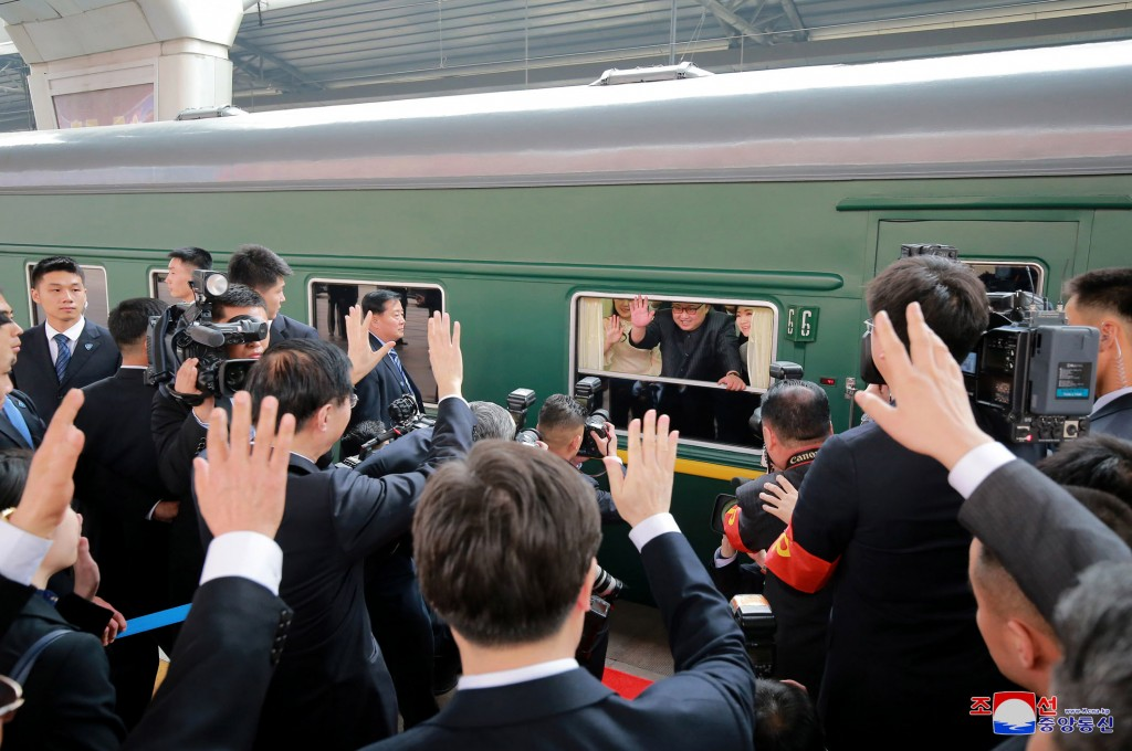 In this March 27, 2018, file photo provided by the North Korean government, North Korean leader Kim Jong Un, center, waves as he was given a send-off ...