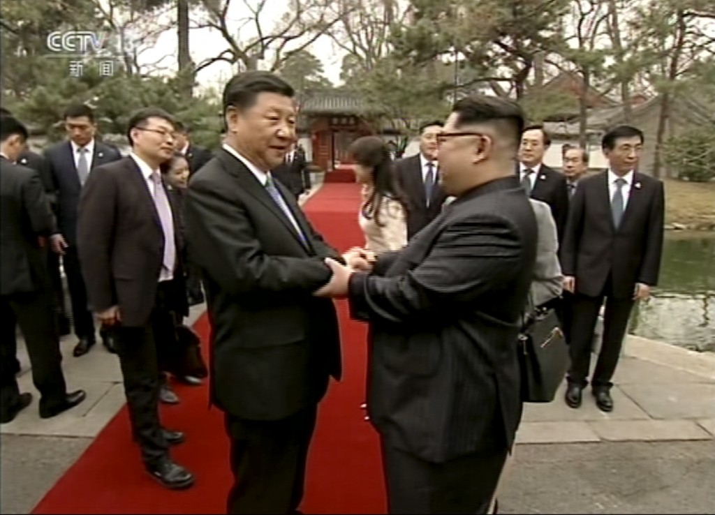 In this image taken from video footage run Wednesday, March 28, 2018, by China's CCTV via AP Video, North Korean leader Kim Jong Un, right, and Chines...
