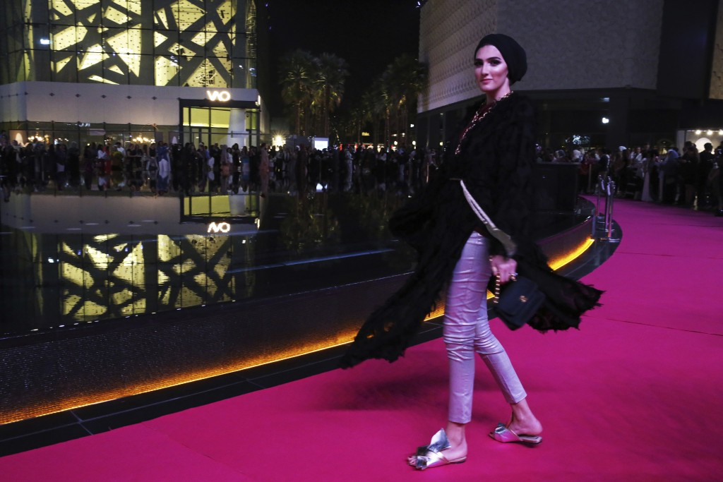 In this Wednesday, March 28, 2018 photograph, a model shows off a modest fashion outfit in Dubai, United Arab Emirates. The Islamic Fashion and Design