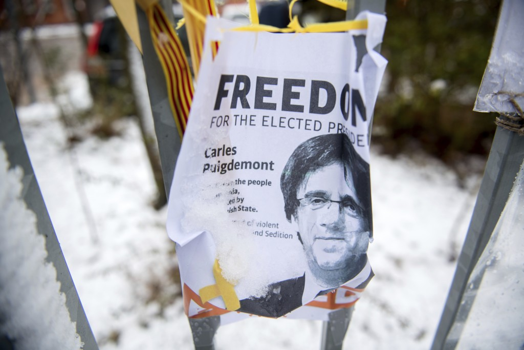 A poster is fixed at the gate to the  entrance building of a prison in Neumuenster, northern Germany, Thursday, March 29, 2018,  where Carles Puigdemo...