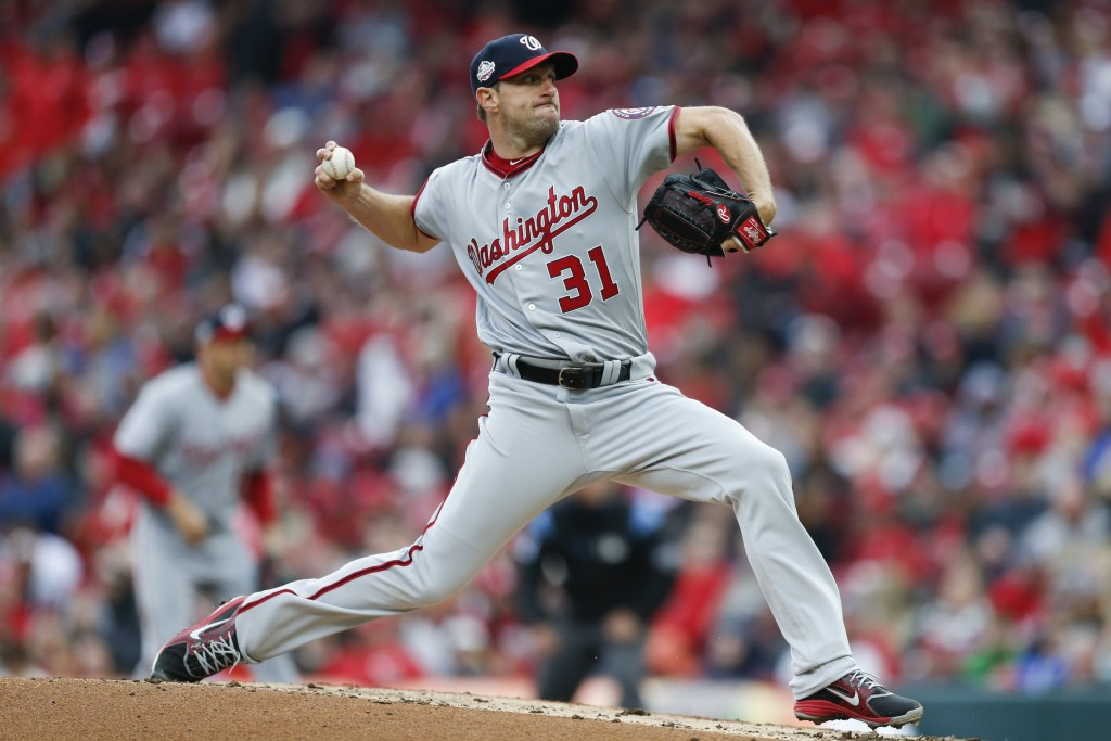 Washington Nationals starting pitcher Max Scherzer throws in the third inning of an opening day baseball game against the Cincinnati Reds, Friday, Mar...