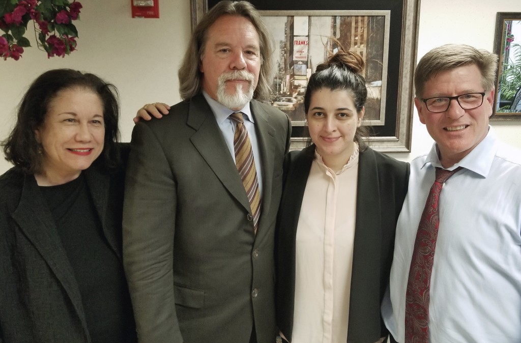 In this Friday, March 30, 2018 photo released by Susan Clary, Noor Salman, second from right, and her attorneys pose for a photo after Salman was acqu...