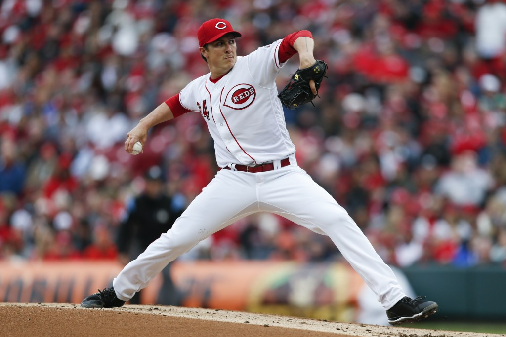 Cincinnati Reds starting pitcher Homer Bailey throws in the second inning of an opening day baseball game against the Washington Nationals, Friday, Ma...