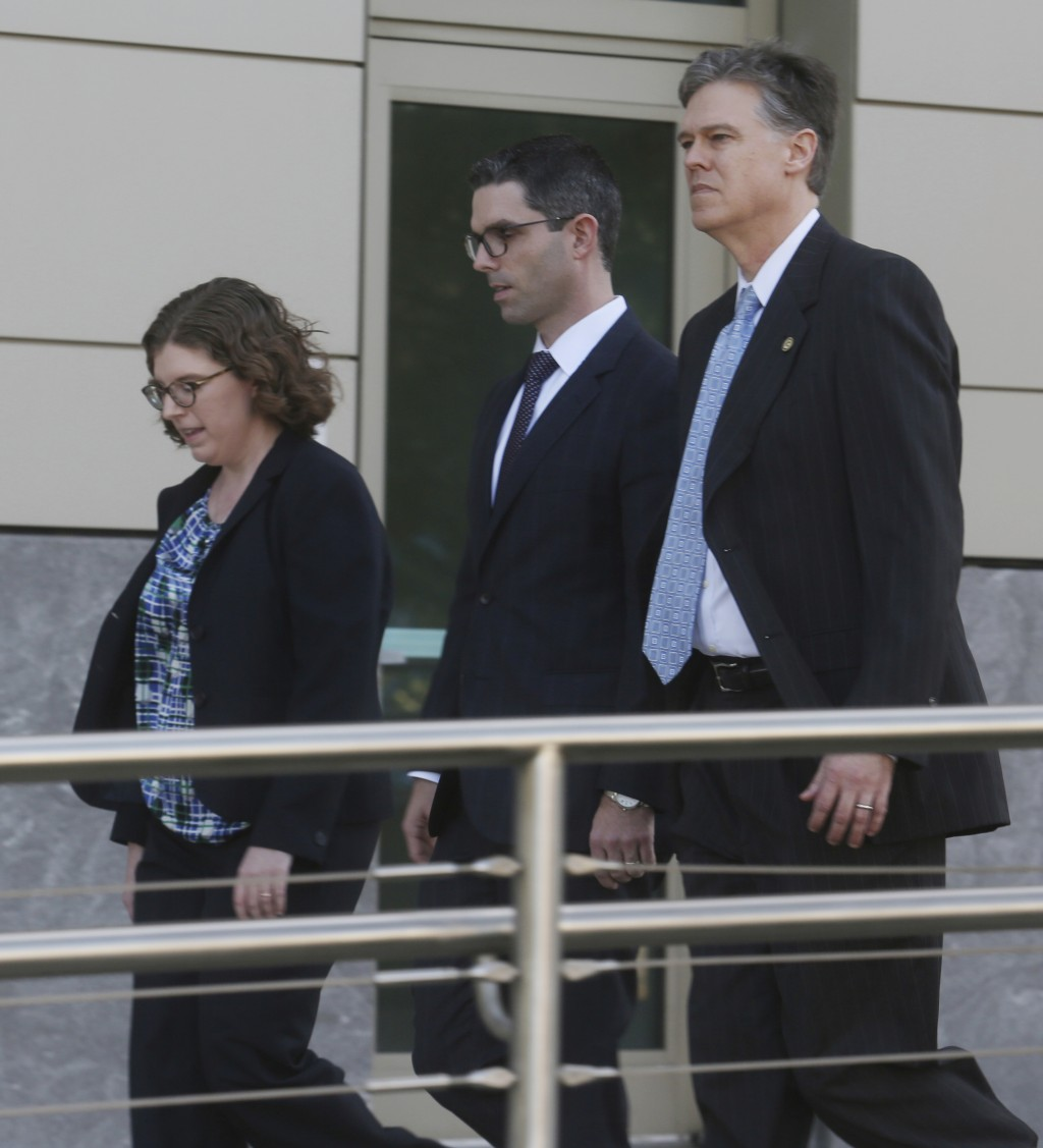 Assistant U.S. Attorney's Sara Sweeney,left, James Gandolfo and Roger Handberg,right, leave the Orlando Federal Courthouse Friday, March 30, 2018 afte...