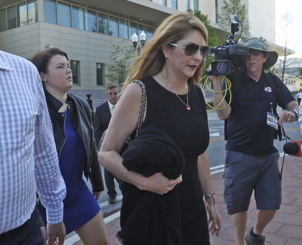 Pulse nightclub owner Barbara Poma ,center, who was present for the verdict, leaves the courthouse with a group of family members of Pulse victims aft...