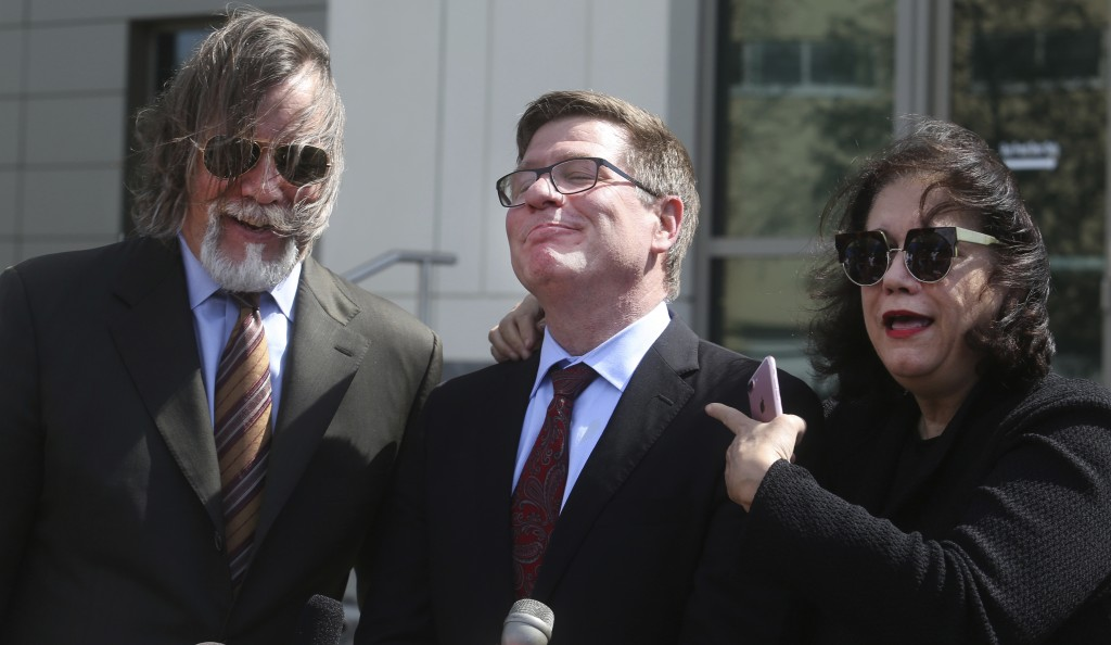 Defense attorney's Fritz Scheller, left, Charles Swift and Linda Moreno for Noor Salman react to a question during a news conference Friday, March 30,...