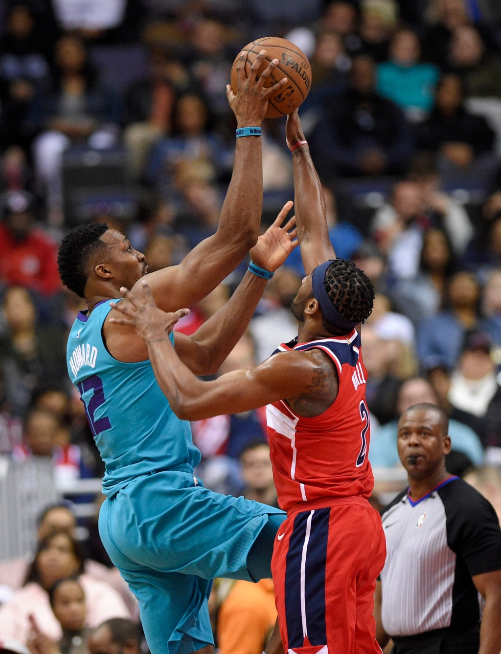 Charlotte Hornets center Dwight Howard (12) goes to the basket against Washington Wizards guard John Wall (2) during the second half of an NBA basketb...