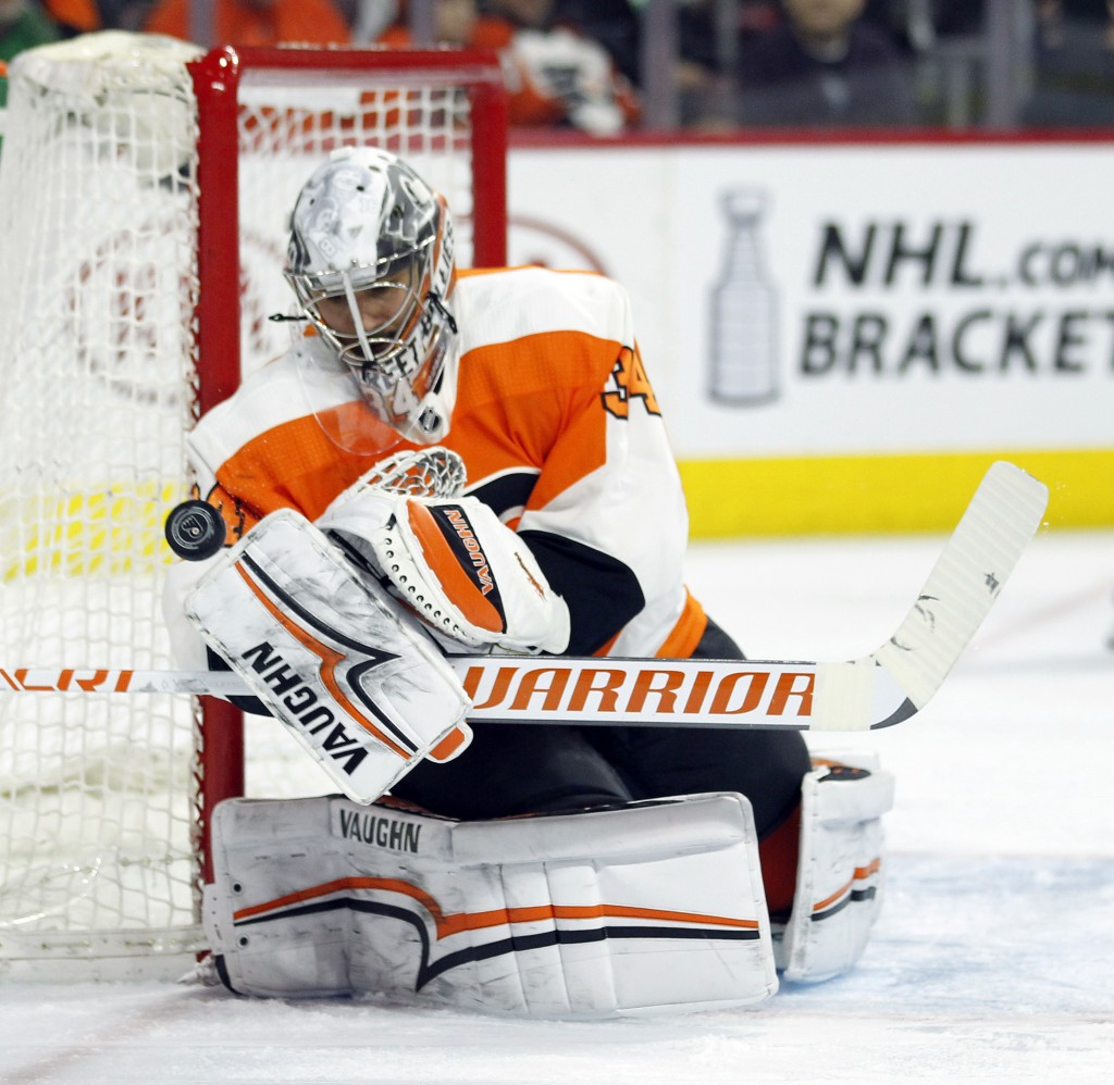 Philadelphia Flyers' Petr Mrazek defends the goal during the first period of an NHL hockey game against the Boston Bruins, Sunday, April 1, 2018, in P...