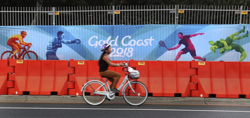 A cyclist rides past Commonwealth Games banner on the side of the road in Gold Coast, Australia, Monday, April 2, 2018. The 2018 Commonwealth Games wi...