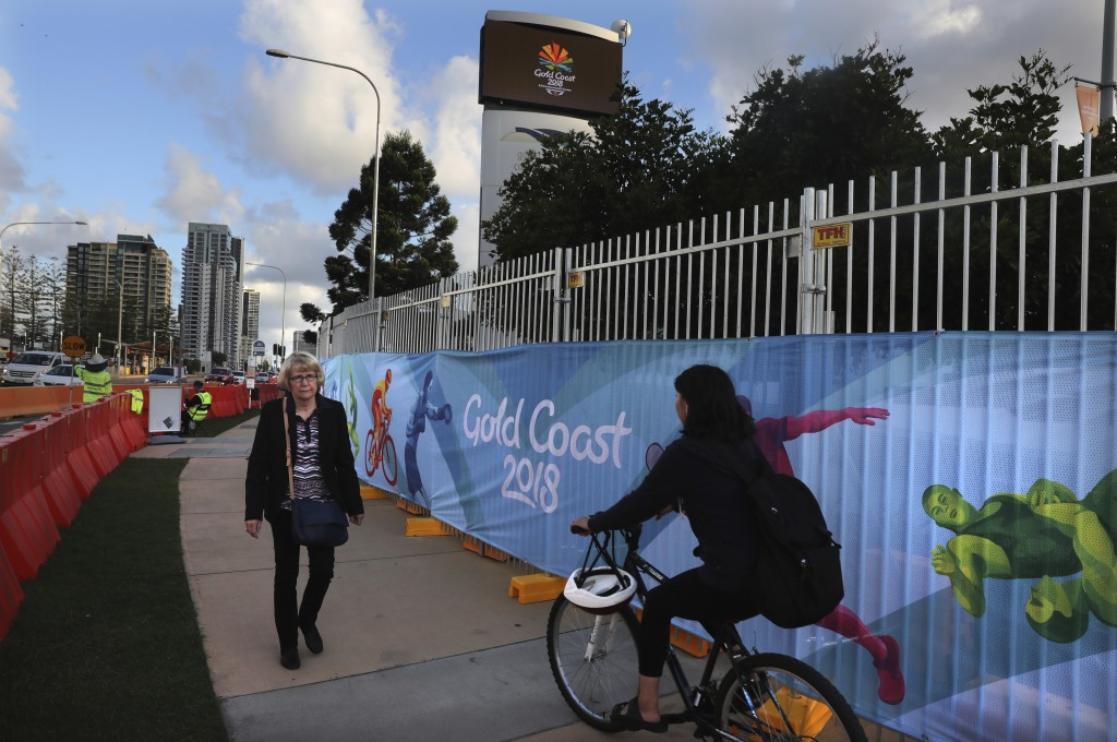 A cyclist rides past Commonwealth Games banners on the side of the road in Gold Coast, Australia, Monday, April 2, 2018. The 2018 Commonwealth Games w...