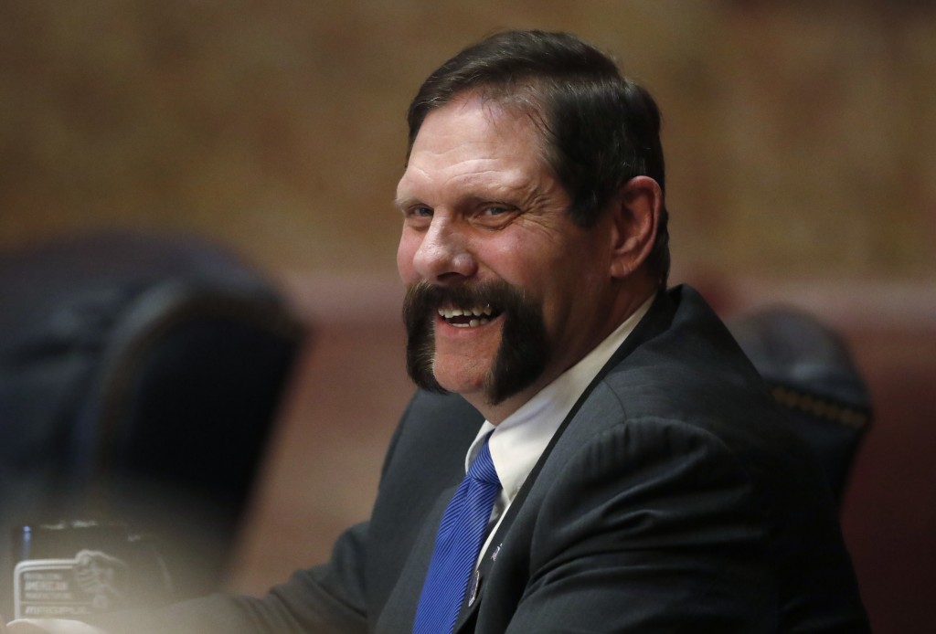 Colorado State Sen. Randy Baumgardner, R-Hot Sulphur Springs, laughs with a fellow lawmaker before a debate on the chamber's floor about a Democratic ...