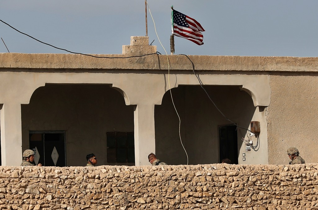 FILE  In this Thursday, March 29, 2018 file photo, U.S. soldiers, left, sit in a house turned into an outpost on a road leading to the tense front lin...