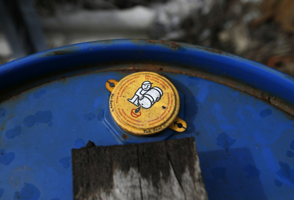 In this photo taken Monday, March 12, 2018, an old barrel full of liquid found at a farm in the northern town of Pancevo, Serbia. Discoveries such as ...