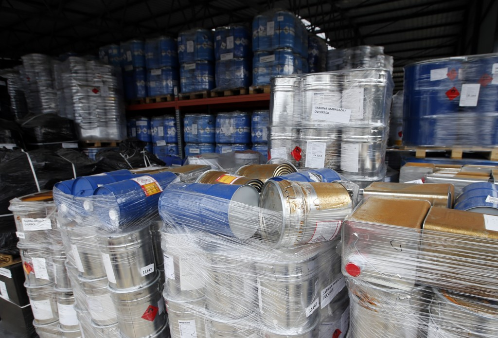 In this photo taken Thursday, March 29, 2018, barrels and containers with dangerous waste which were found abandoned are temporarily stored, in Belgra...