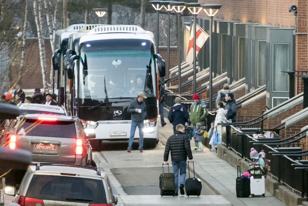 Buses wait to carry expelled diplomats to leave the U.S. Embassy in Moscow, Russia, Thursday, April 5, 2018. Russia last week ordered 60 American dipl