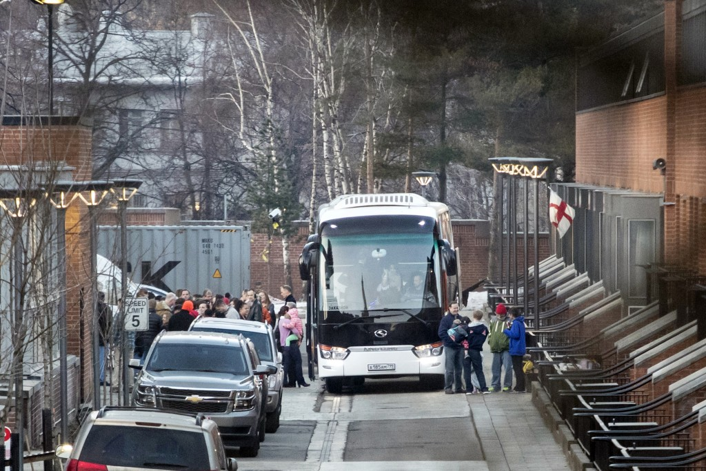 Buses wait to carry expelled diplomats and their f...