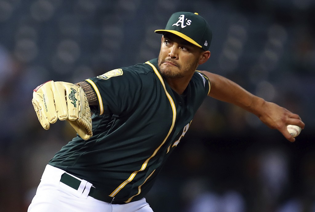Oakland Athletics pitcher Sean Manaea works against the Texas Rangers during the first inning of a baseball game Wednesday, April 4, 2018, in Oakland,...