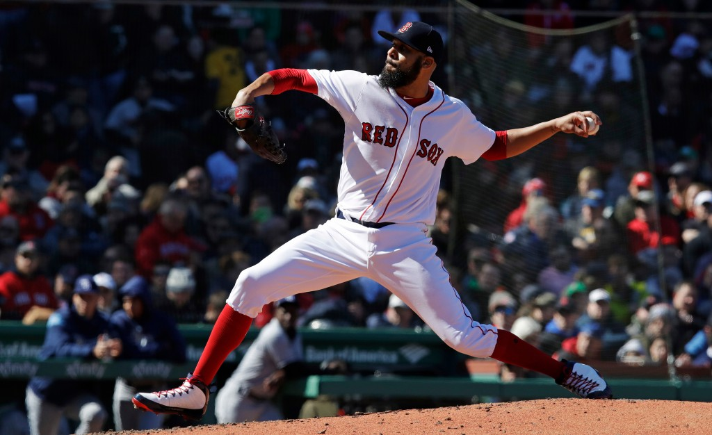 Boston Red Sox starting pitcher David Price delivers during the third inning of a baseball game against the Tampa Bay Rays at Fenway Park in Boston, T...