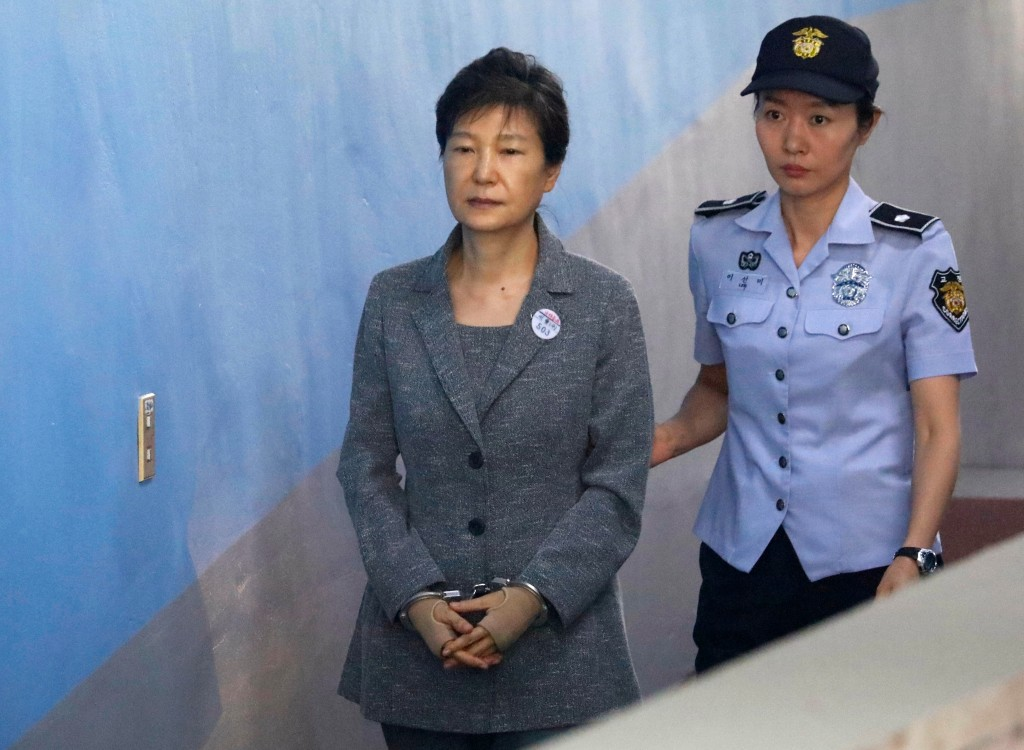 FILE - In this Aug. 25, 2017, file photo, former South Korean President Park Geun-hye, left, arrives for her trial at the Seoul Central District Court...