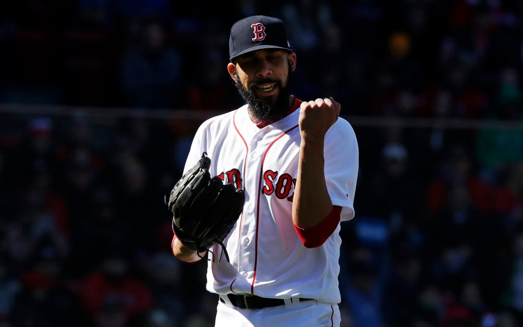 Boston Red Sox starting pitcher David Price pumps his fist after getting Tampa Bay Rays' Brad Miller to fly out, with two on base, to end the top of t...